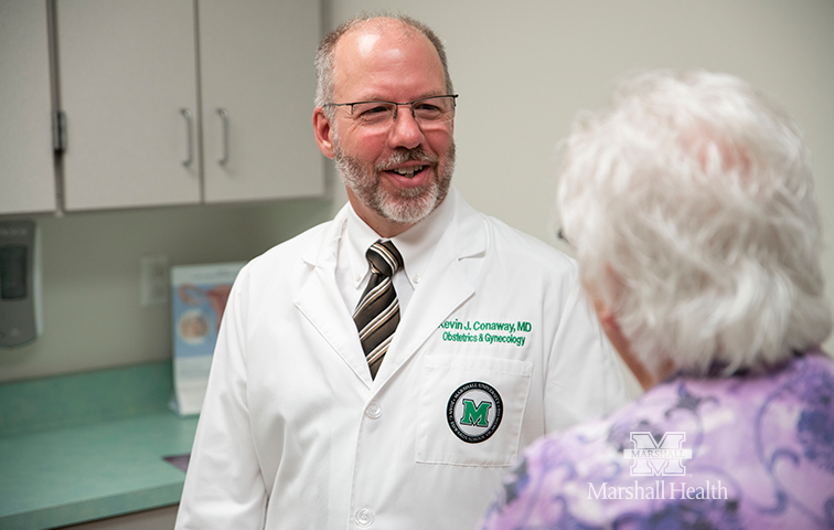 Dr. Conaway with a patient
